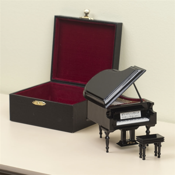 miniature grand piano figurine with case at the music stand