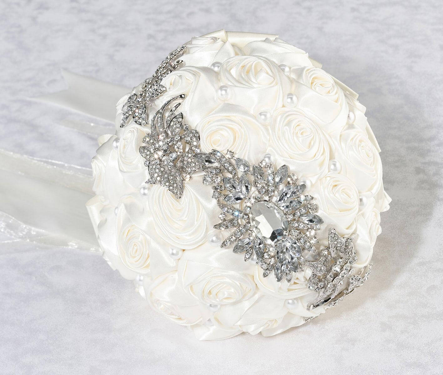 Crystal brooch bouquet with off white satin roses izmirmasajfo