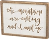 """The Mountains Are Calling & I Must Go"" Distressed Wood Trimmed Sign"