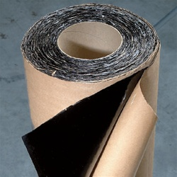 Strip-N-Flash is a 40 mil. thick waterproofing membrane consisting of a self-adhering rubberized asphalt laminated to a high density polyethylene film. A special release liner prevents the membrane from sticking to itself in the roll. The heavy polyethyle