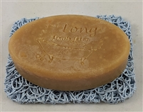 judith's goat milk soap in an oval mold on a soap dish by Wood 'n' Potter.
