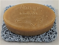 judith's unscented goat milk soap in a rectangular design on a soap dish made in the mountains of North Carolina.