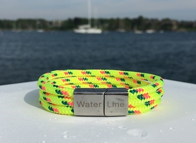 The Limoni di Capri bracelet is a vibrant yellow color. With its stainless steel magnetic clasp and triple line design, it is both comfortable and secure, ready for boating and days at the beach.