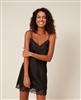Beautiful black silk chemise featuring a delicate lace trim and a band of tulle that highlights the neckline