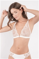 Ivory and nude soft triangle bra with floral lace, no underwire and exposed clasp fastening at front