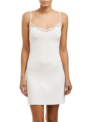 Ivory microfibre slip that sits above the knee, featuring a v-neck with adjustable straps and trimmed with lace