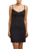 Black microfibre slip that sits above the knee, featuring a v-neck with adjustable straps and trimmed with lace