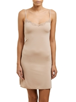 Nude microfibre slip that sits above the knee, featuring a v-neck with adjustable straps and trimmed with lace