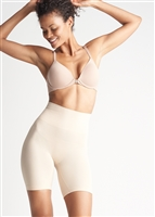 Nude mid waist thigh shaper with an extra wide shaping band and a comfortable side-seam free construction