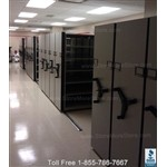 "Pre-owned High Density Mobile Shelving System manufactured by Spacesaver that will hold legal, letter, or storage boxes. Mobile shelving is 13'-6"" wide X 7'-10 ¾"" deep X 6'-6 1/8"" high. Used compact shelving systems"