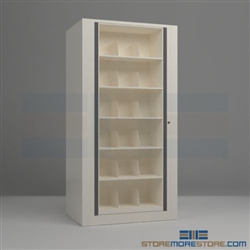 rotary file cabinets or rotating filing shelves that hold end tab file folders in a cabinet that rotates and locks