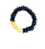 Women's stretch bracelet with black glass beads and gold twisted discs.