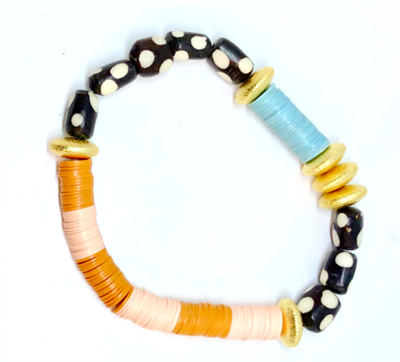 women's stretch bracelet with black and white polka dot beads and gold discs