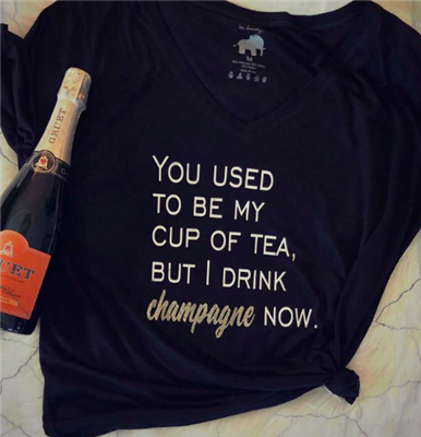 black short sleeve tee that says you used to be my cup of tea, but I drink champagne now
