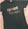 "women's grey short sleeve t-shirt that says ""Damaged but Adorable"" foil in rose gold"