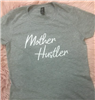 be dainty women's gray short sleeve t-shirt that says Mother Hustler in white