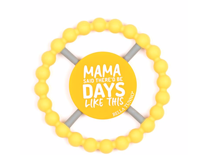 "Yellow teething ring that says ""Mama Said There'd Be Days Like This""."