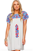 women's white mini dress with blue and red embroidery