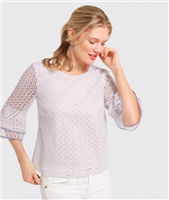 white blouse with lattice point cutout trimmed in seersucker with a bell sleeve