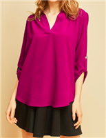 fuchsia polyester v-neck blouse with permanent button closure at sleeve with a rounded hem
