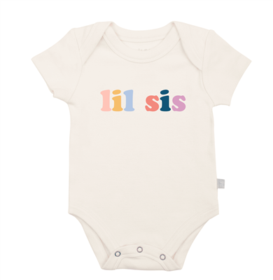 Baby cotton onesie that says Little Sis on the front.