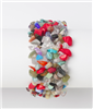 "1 1/2"" wide stretch bracelet with acrylic  multicolored pieces attached"