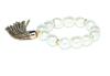 faux pearl stretch bracelet with gold beaded tassel