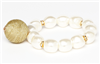 faux pearl stretch bracelet with gold fabric ball charm