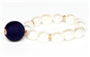 faux pearl stretch bracelet with blue fabric ball charm