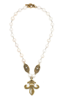 18 inch strand of white fresh water pearls with a grand Fleur Medallion necklace
