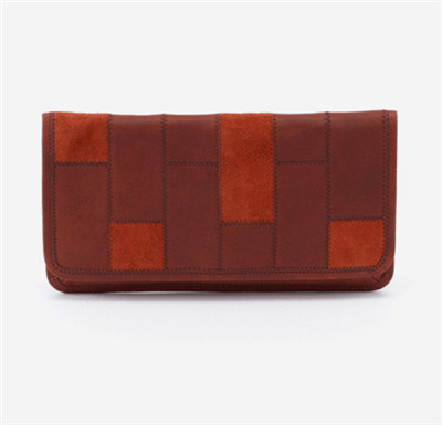 ladies leather clutch with patchwork on the front in chestnut