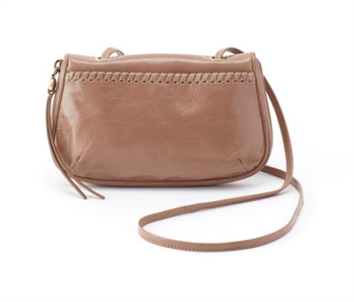 ladies leather cross body bag on taupe