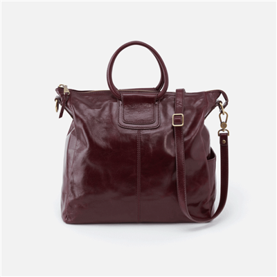 ladies leather handbag in deep plum with double handle and lone removable strap