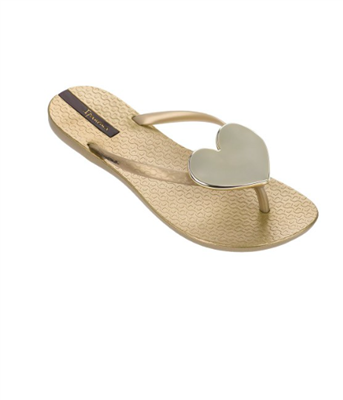 women's Ipanema gold plastic flip flops with a gold heart medallion
