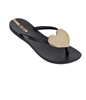women's Black plastic flip flops with a gold heart medallion