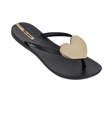 Black plastic flip flops with a gold heart medallion