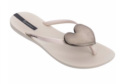women's beige rubber flip flops with a black heart medallion