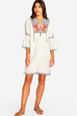 ladies sand colored linen dress with colorful embroidery on the front and a flare sleeve