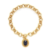 18 inch gold chain necklace with a sapphire blue glass pendant