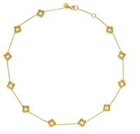 ladies slender gold chain with 11 quatrefoil stations