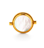 ladies gold ring with mother of pearl on one side and gold medallion on the other