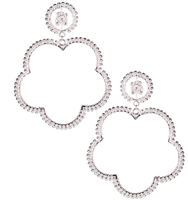 Silver earrings that are 3 inches shaped like a flower