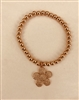 8 inch rose gold beaded stretch bracelet with a crystal flower charm