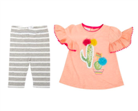 toddler gray leggings with with white scalloped details and a cute peach color top with ruffle details, pom poms and tassels
