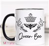 "white 11 ounce ceramic mug that reads ""queen bee"""