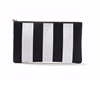 Women's black and white stripe top zip clutch