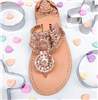 rose gold leather slip on flat sandal with white whipstitch detail