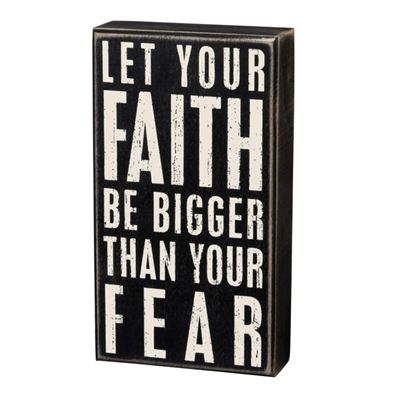 "black box sign that say""let your faith be bigger than your fear"""