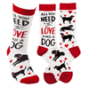 "women's white socks that read ""All you need is love and a dog"""