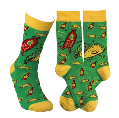 green socks that have tacos and bottles of hot sauce on them